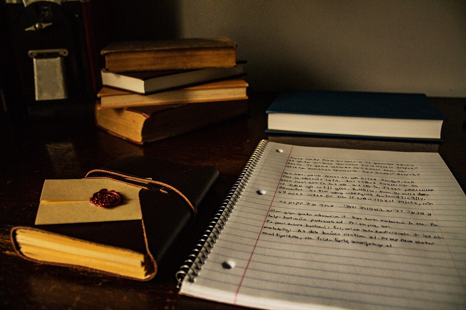 Books And A Notebook With Notes