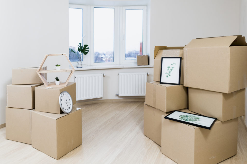 Packed moving boxes in a room.