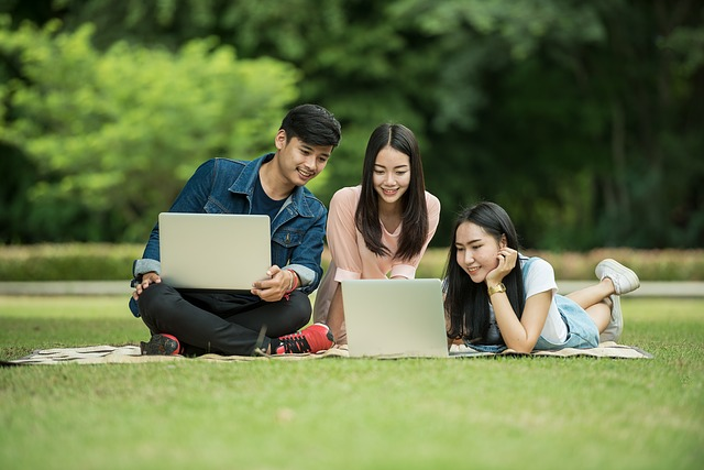 College students learning together in a park.