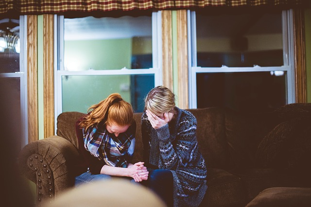 Two Woman Sitting On A Couch And Crying Instead Of Setting The Boundaires Before Moving In With A New Roommate.