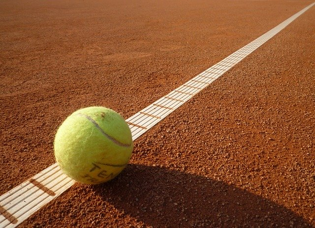 A tennis ball on the line.