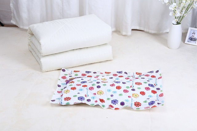 Vacuum bags and some white bed covers.
