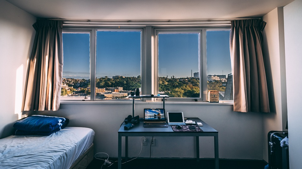 Dorm room with a lot of natural light.