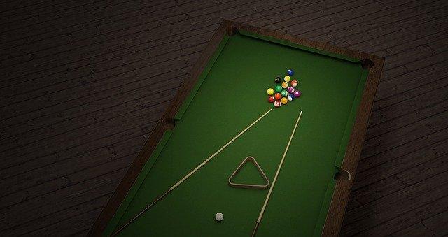A black pool table.