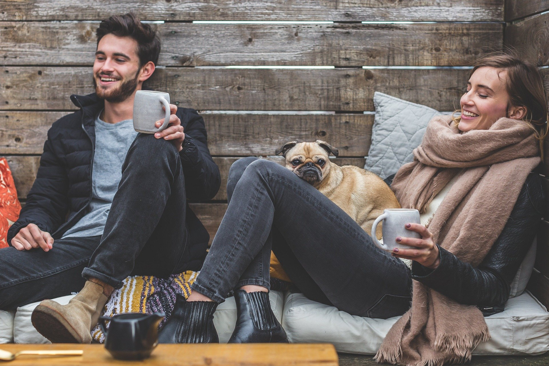 A couple smiling as you will be doing after moving in with your partner.