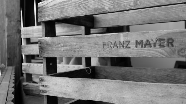 A wooden crate in black and white.