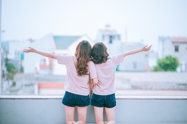 Two Friends Ona Balcony.