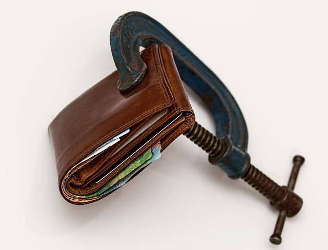 A Squeezed Wallet Symbolizing Low-budget Moving Tips