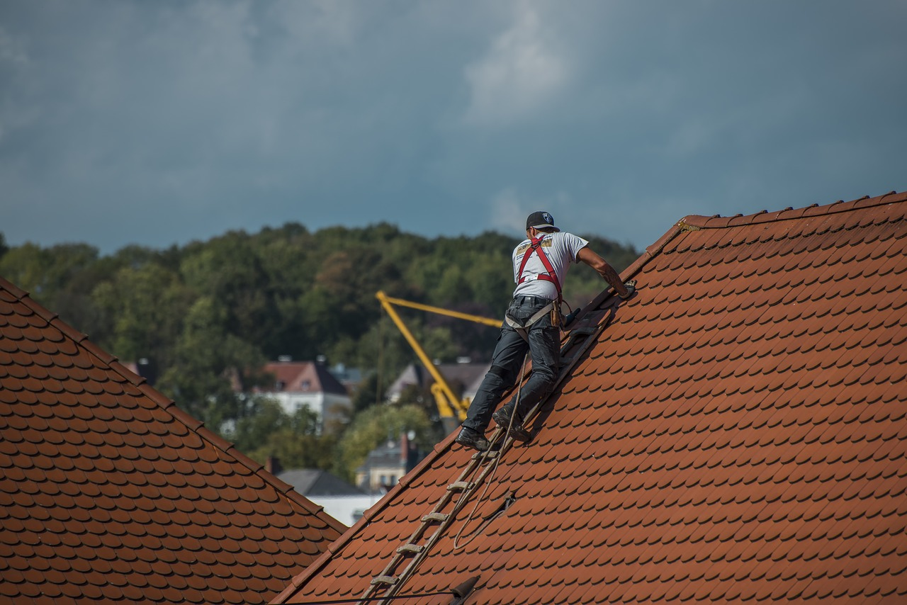A professional working on removing old antennas from your roof.