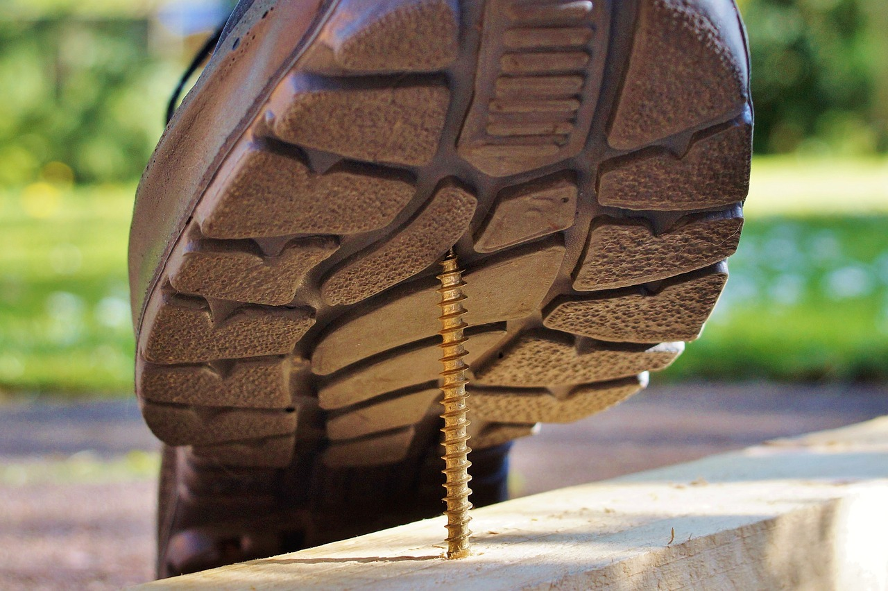 A boot about to step on a screw.
