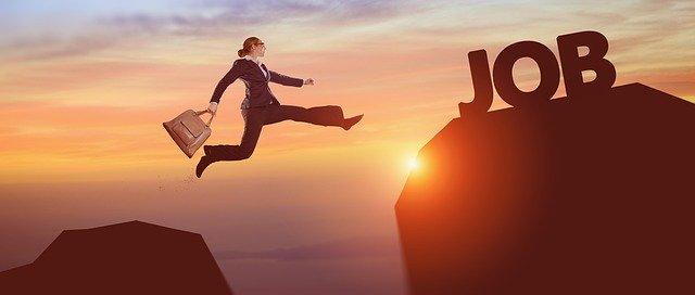 A businesswoman jumping.