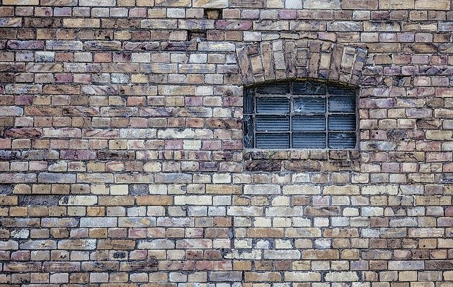 An old window on the brick wall.