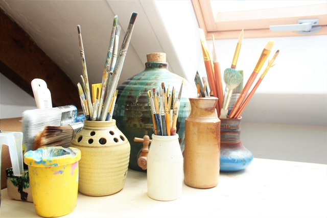 Paint brushes in their jars