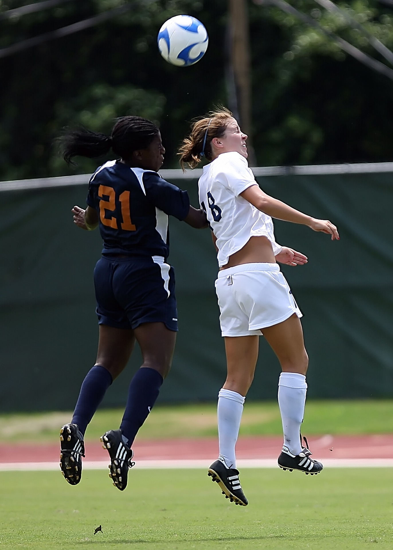 Two female soccer players in action.
