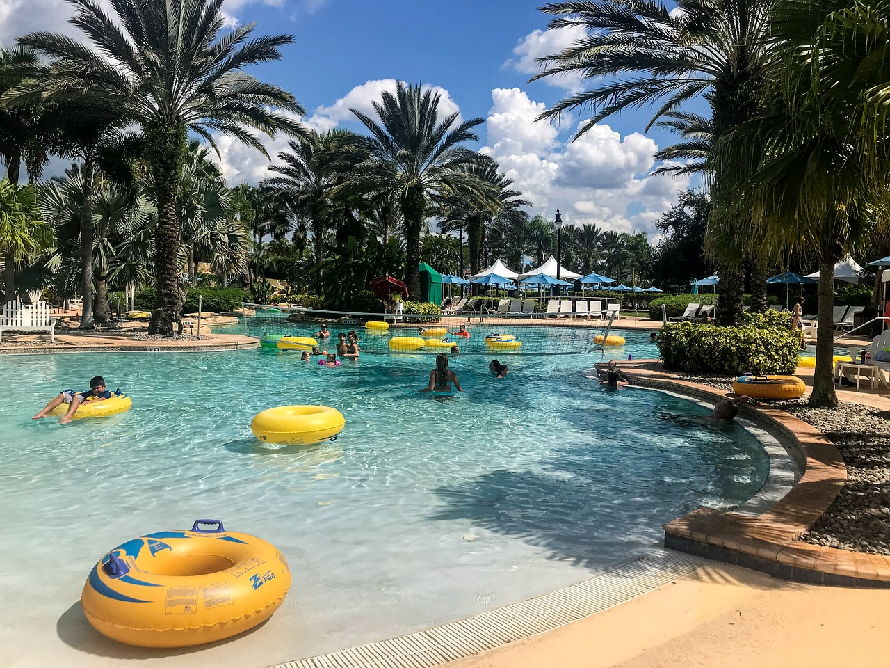 Water Park pool with floats and people swimming.
