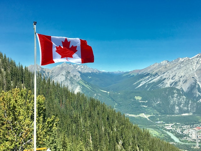 Canada's top 5 safest cities with Canadian flag.