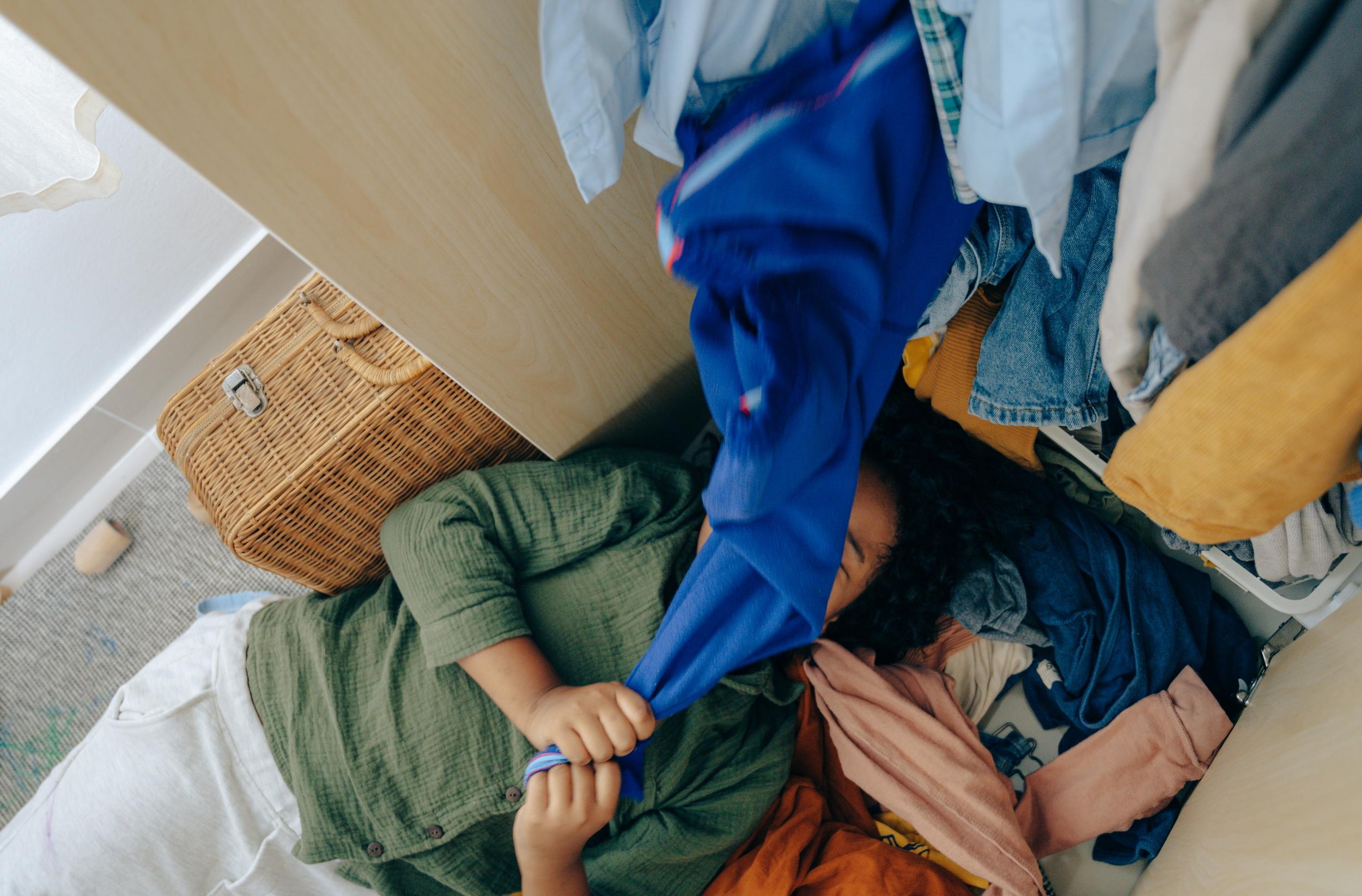 A woman is decluttering her wardrobe.