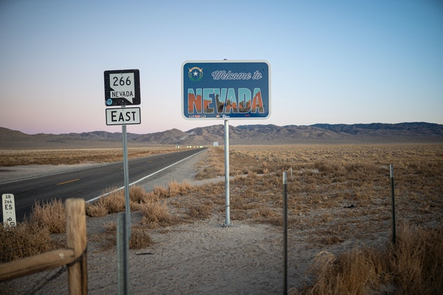 A welcome to Nevada sign in the desert
