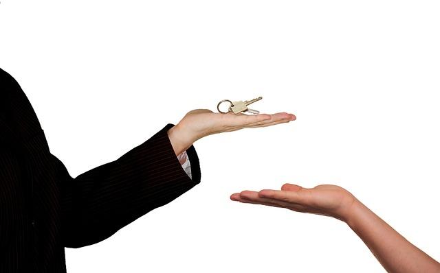 Realtor Hands Key