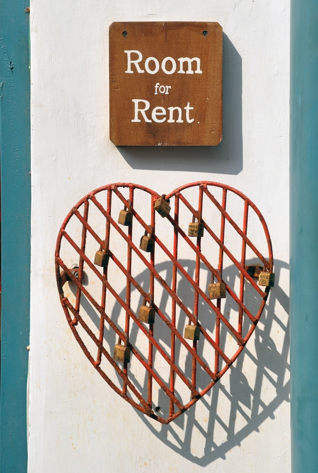 An image with a room for rent sign, asking for rent when finding a shared apartment in Grove City is a must