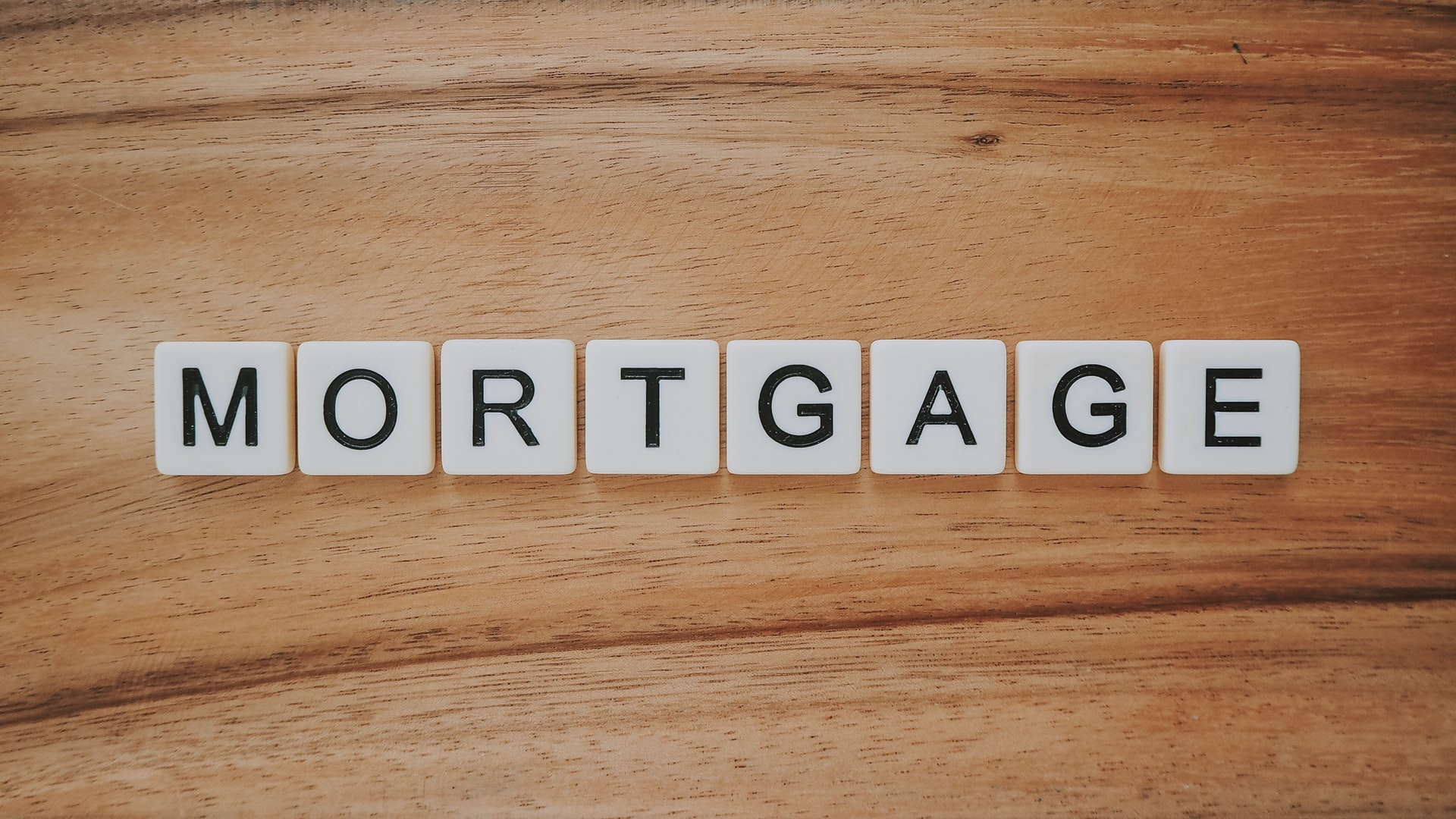 Scramble letters forming the word  Mortgage.