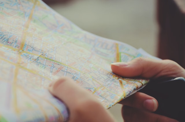 An image of a man holding a  map
