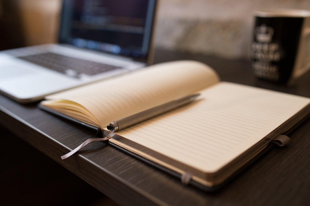 A pen and a notebook to write down a business plan when launching a start up company in Brampton.
