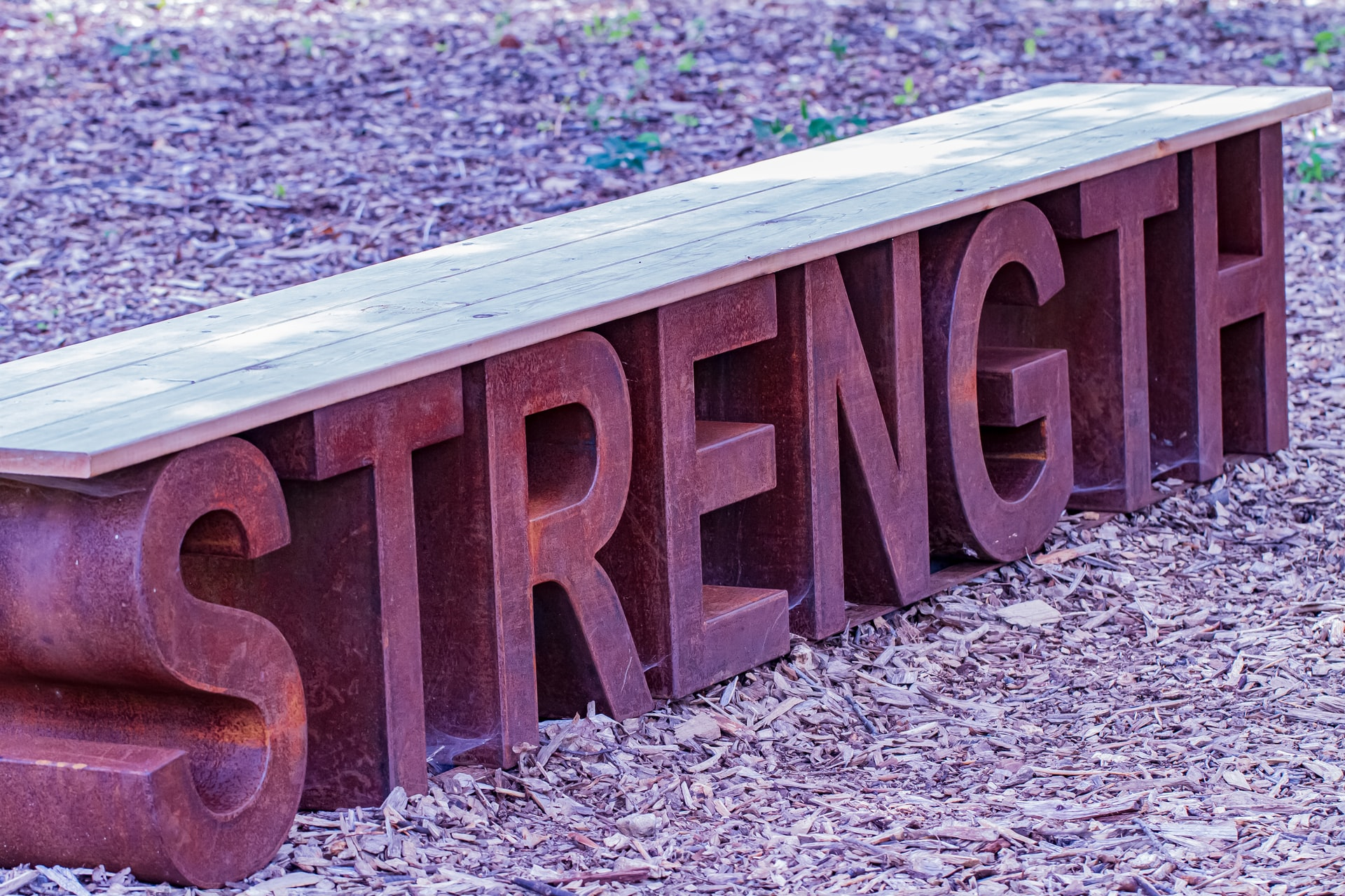 an image of a  red sign that says strength