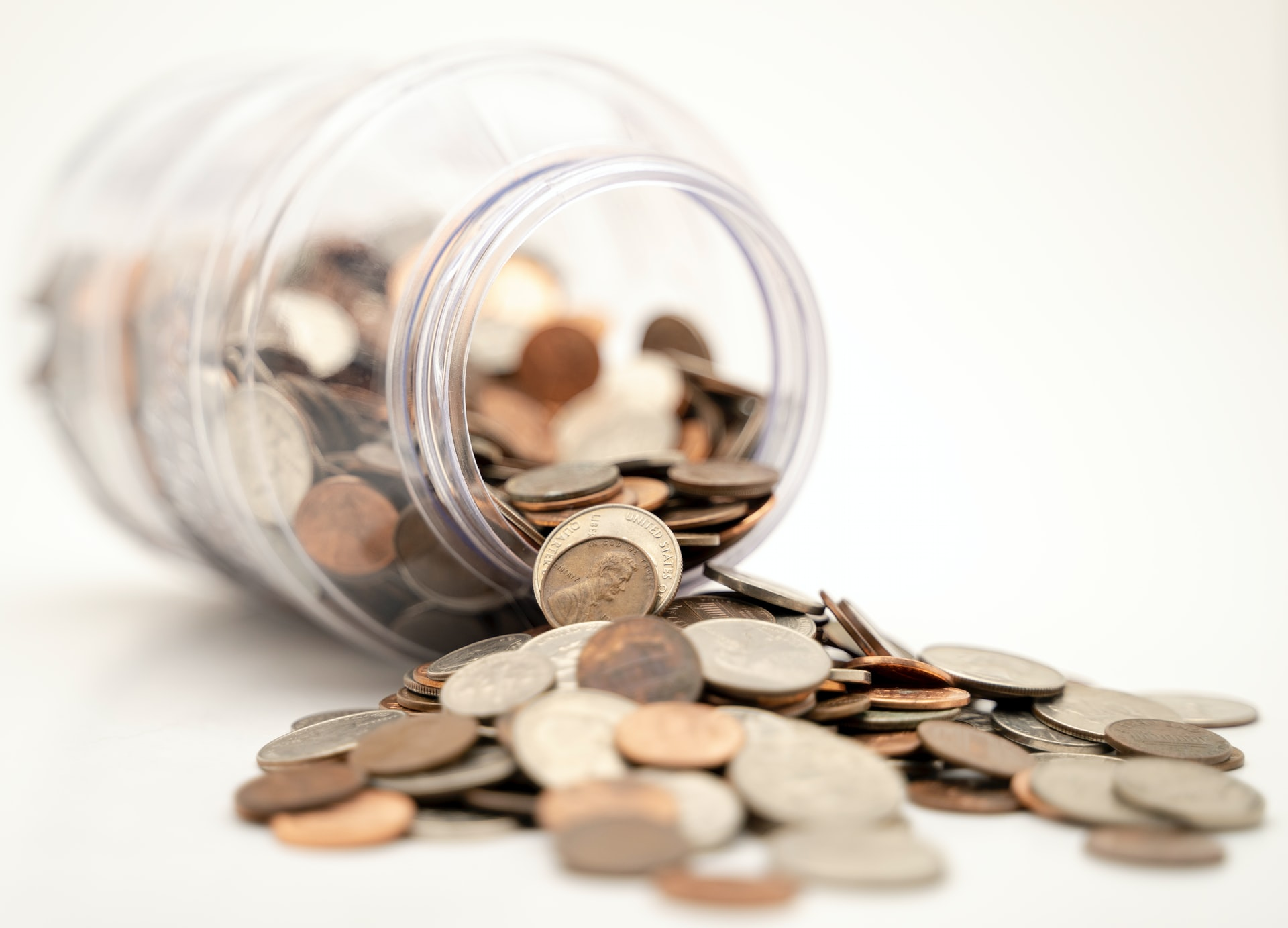 An image of a  jar filled with coins