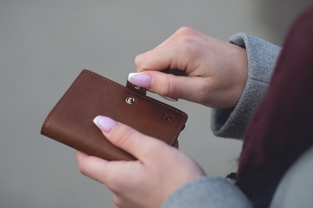 A female person opening her wallet